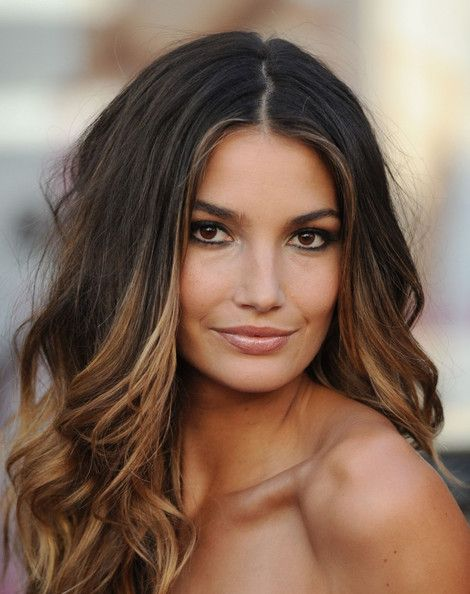 Lily Aldridge's naturally dark locks are brightened...Note to everyone wanting color like this...notice everyone has there hair curled or waved...not as hot straight....