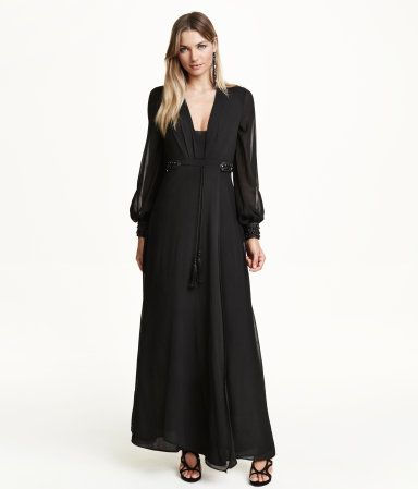 V-neck maxi dress in double-layer chiffon with long sleeves. Beaded tie belt and beaded cuffs in imitation leather. Pleats at front, seam at waist, and wrap-style skirt. Concealed zip at back.