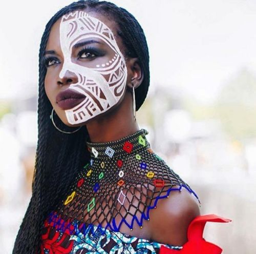 The beautiful Nykhor Paul @ Afro Punk. Face painting by Laolu Photography by Lauren Cowart