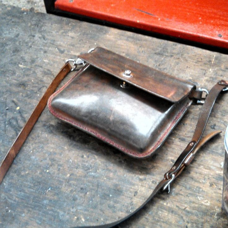 One of our #purses #atwork on a #glassblowing bench. #womanbags #womensaccessories #rusticelegance #madeinminnesota #madetolast #minneapolis  Several years old now but still going strong.