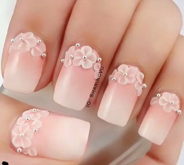 A wonderful looking gradient technique using nude and white nail polish. To make the nails stand out even tinier flower embellishments are placed on the cuticle edge of the nails complete with silver beads on top.