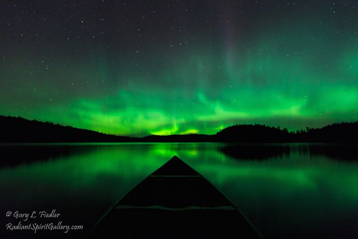 Canoeing under a star-filled sky splashed with the aurora is one of the most enjoyable and memorable experiences of a wilderness canoe trip. Photo by Gary Fiedler
