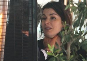 Captured in a series of shocking photos, British television chef Nigella Lawson appeared to have been choked by her husband Charles Saatchi as an argument turned violent during a restaurant outing on June 9.