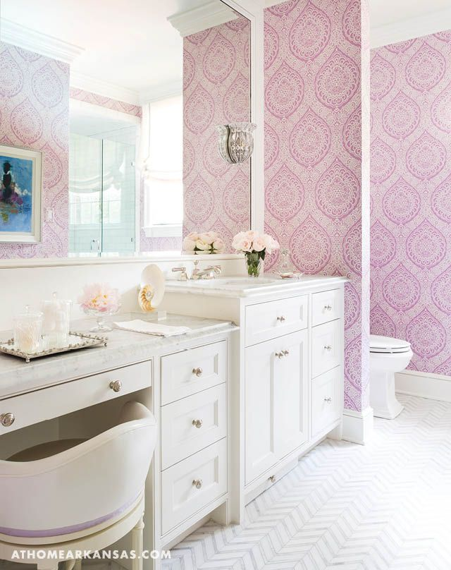 The girl's bath features a paisley wallpaper by TKTK and custom marble flooring laid in a herringbone pattern.  | Home At Last | At Home in Arkansas | August 2016 | Bathroom | @bearhillint