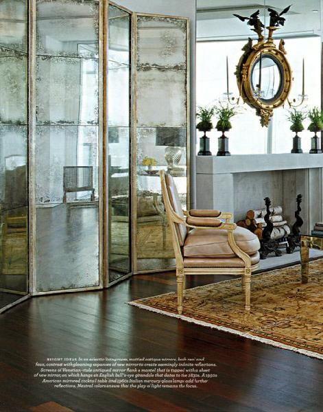 Floor length folding mirror // mirrors, ornate chair, armchair, modern fireplace, ornate mirror, convex mirror, area rug, hardwood floor