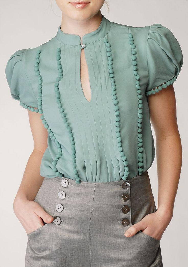 Nice color combo. Don't like the puff sleeves though. Love the buttons on the pants
