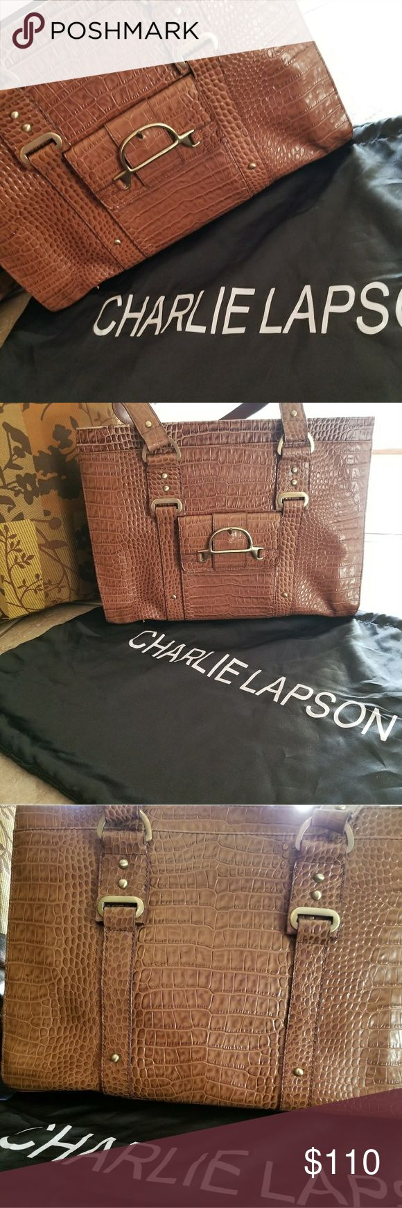 Charlie Lapson Tote Large Brown crocodile embossed leather features double strap with 2 large outside pockets along with 1 small front outside pocket. Purse features a zipper compartment on inside. No stains, pen or pencil marks on inside. Straps not worn. Gently worn once. Purse a little dented from storage only. Comes with original storage bag. Charlie Lapson is known for making exclusive leather handbags for the stars! An original purchase from formerly known Shop Nbc. Charlie Lapson Bags…