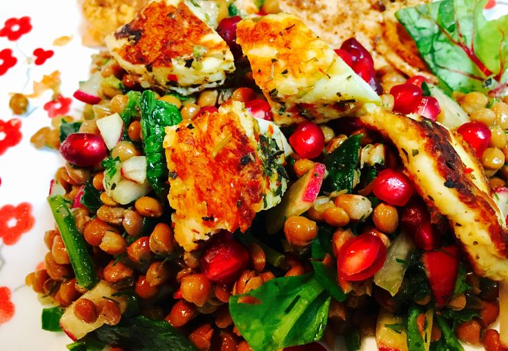 Lentil salad with fried haloomi and pomegranates