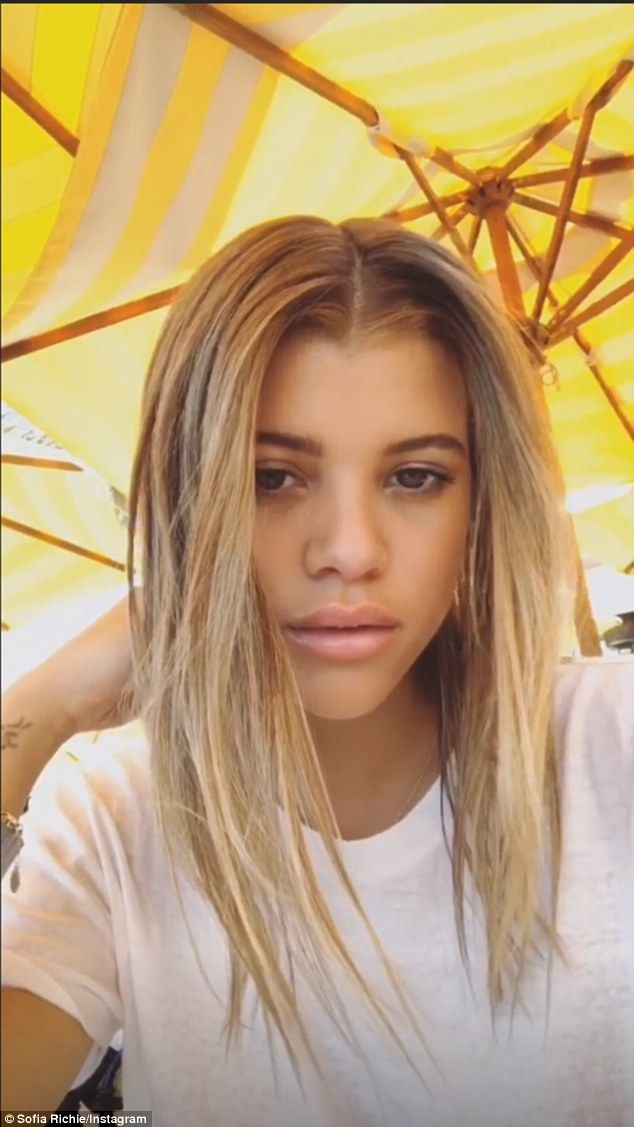 27544c0230 Sofia Richie shows off her abs as she gets new blonde hair extensions