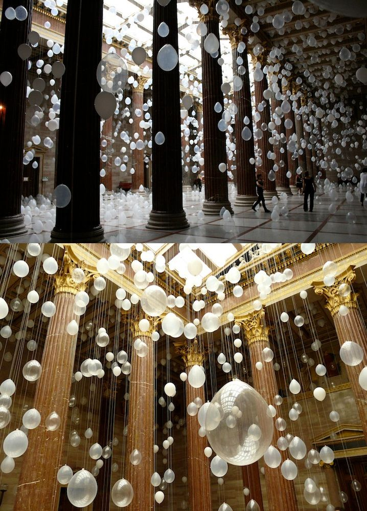 Many clear white balloons hanging down tying the knot 6 for Cool picture hanging ideas
