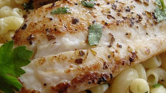 Tender tilapia fillets are seasoned with lemon and herbs, and served over Parmesan pasta for a light, fresh taste.
