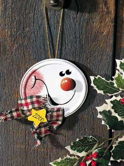 JAR or CAN LID SNOWMAN ORNAMENT... paint a snowman on it or you could use old Christmas card pics to make really pretty decorations and even go with a theme...inexpensive and pretty!!!