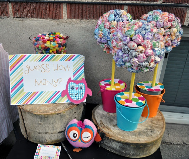 """The Lollipop Tree!! I used Tootsie Pops instead of DumDums and adorned it with an image of the Tootsie Pop Owl and a sign saying """"Mr. Owl, How many Tootsie Pops does it take to make a Tootsie Pop Flower?"""""""