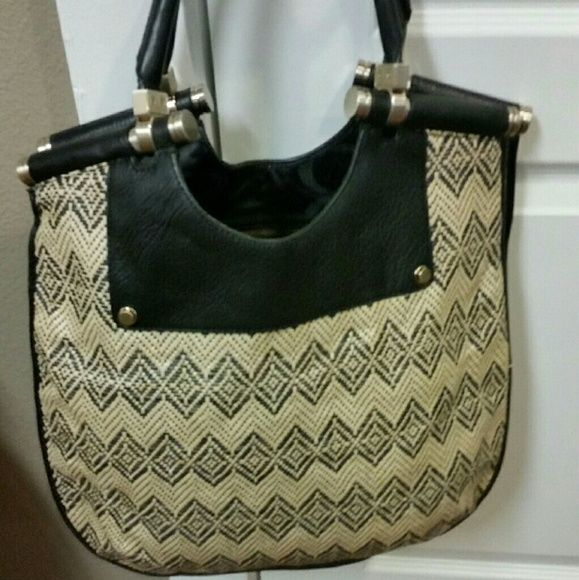 Banana Republic Handbag Straw bag trimmed with black leather and brass hardware. Excellent condition. Banana Republic Bags Shoulder Bags