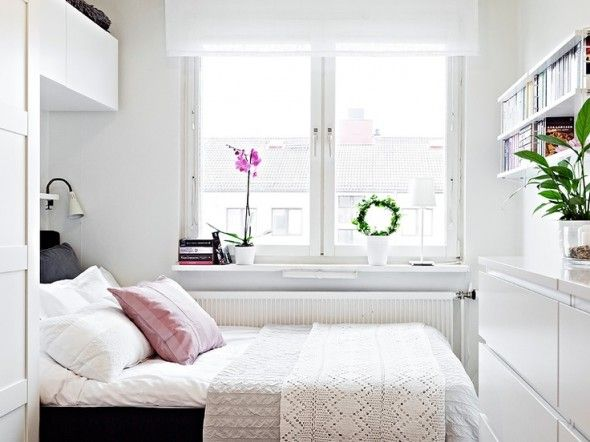 small bedroom idea -- shoe storage on wall at foot of bed