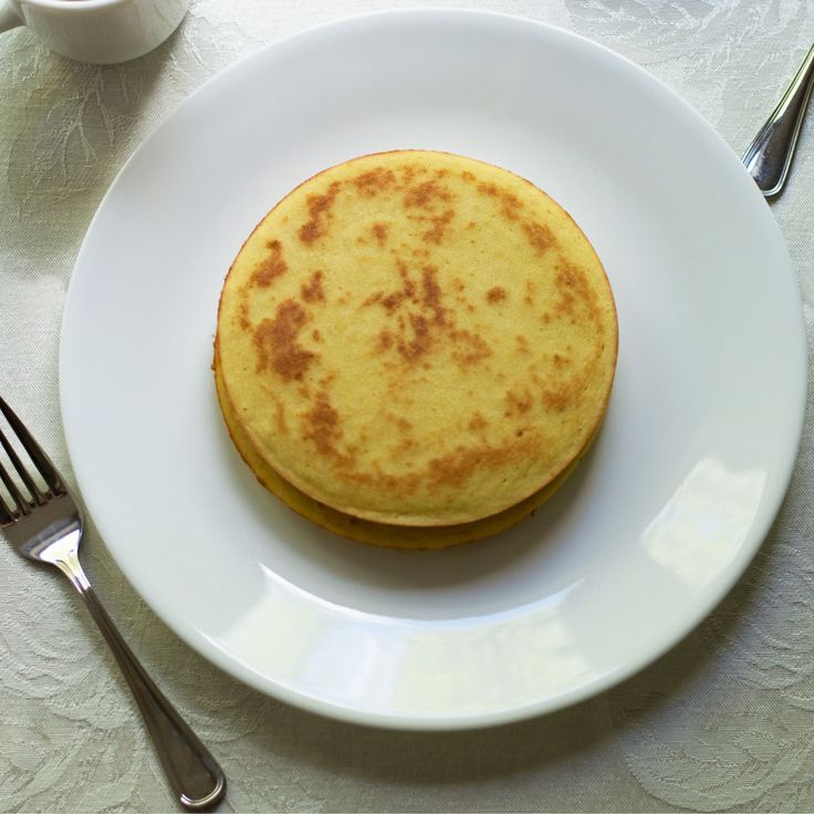 A fiber rich low carb coconut flour pancakes recipe that is gluten free, grain free. Only 120 calories and 2 net carbs per pancake.