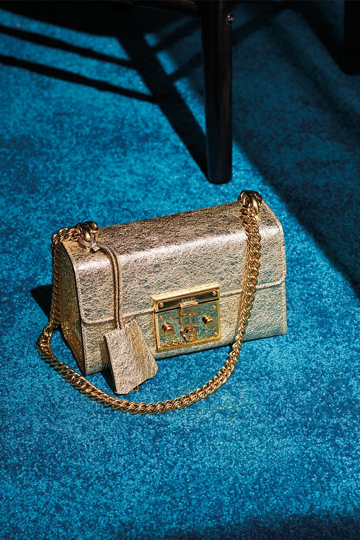 The compact structured Padlock shoulder bag in crackled laminated platinum leather and a key lock closure from the Gucci Cruise 2016 collection.