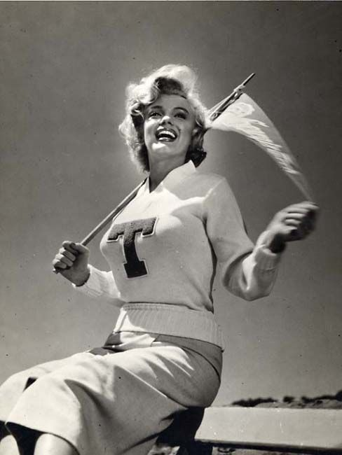Marilyn Monroe photographed supporting the Georgia Tech football team in 1952, by Bob Sandberg.