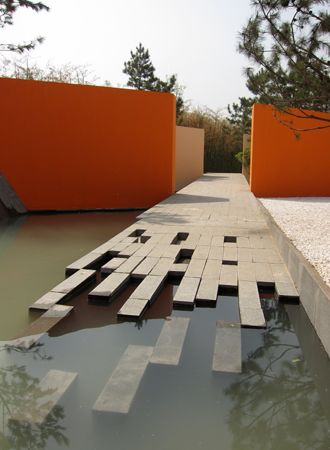 V. Sitta. The use of the orange walls to bring  light to the space while also breaking up the ground plane toward a void