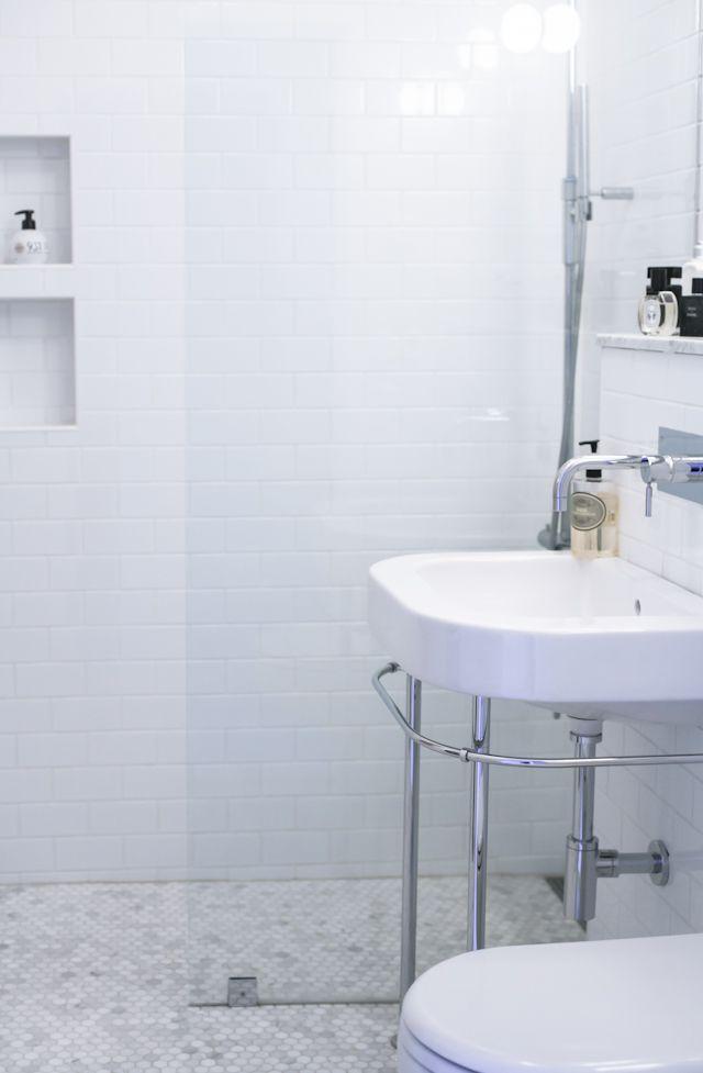 Bathroom with hexagon tiles on floor and metrotiles on wall