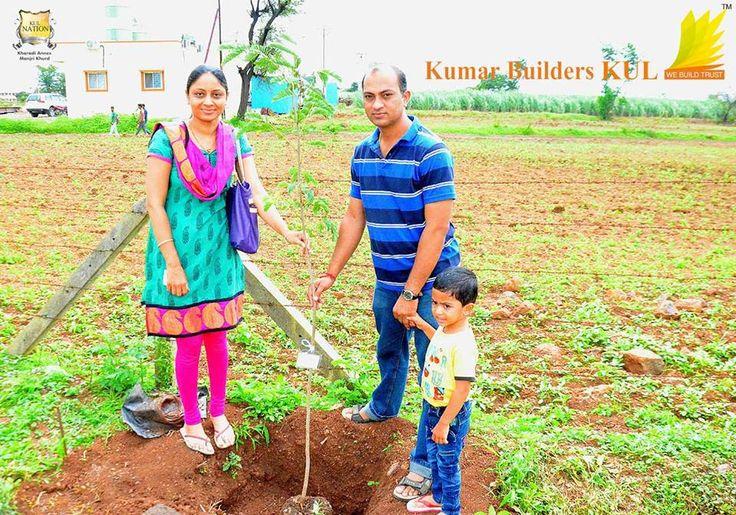 KUL Citizens planting a tree during Tree Plantation Ceremony organized by Kumar Builders KUL.