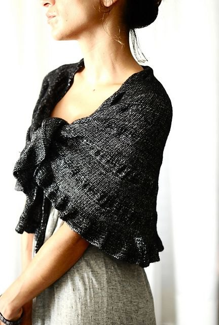 free knit shawl pattern, approx. 800 yards of sock yarn... do with a glittery yarn for a nice festive wrap?