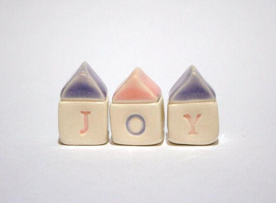 mini clay houses found at thelittlereddoor on Etsy.