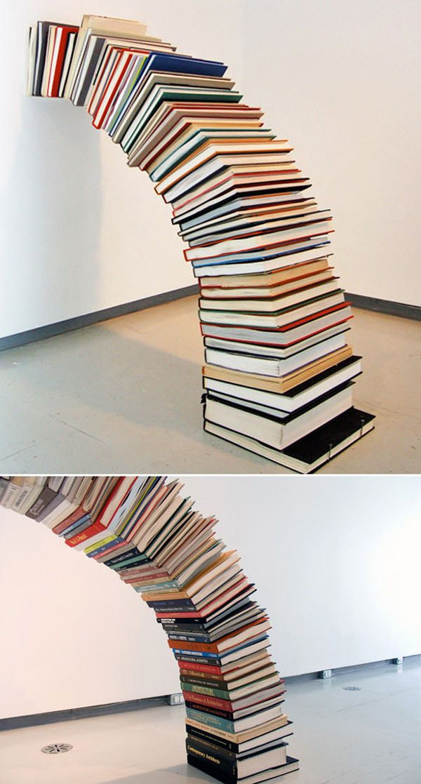 Book installation by Miler Lagos on Colossal via CollabCubed.