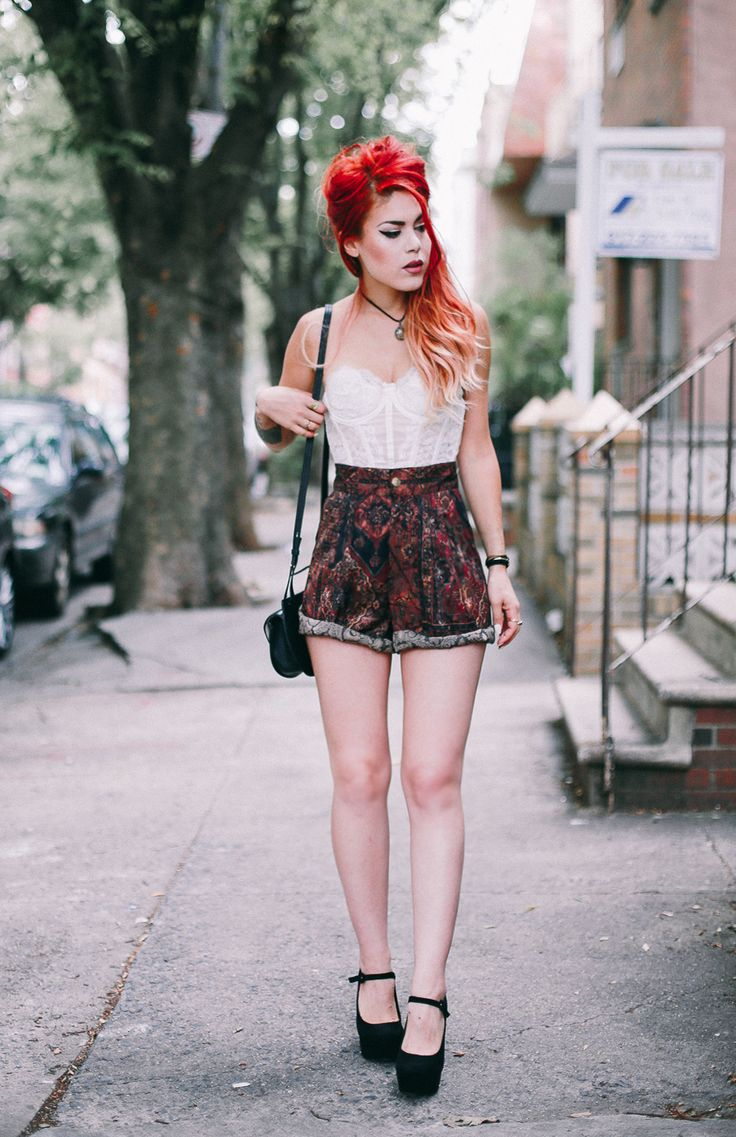 Le Happy wearing vintage shorts and white lace bustier