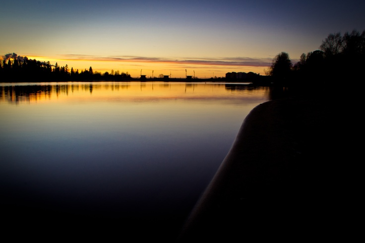 Waiting for sunset by the Oulu river in Finland