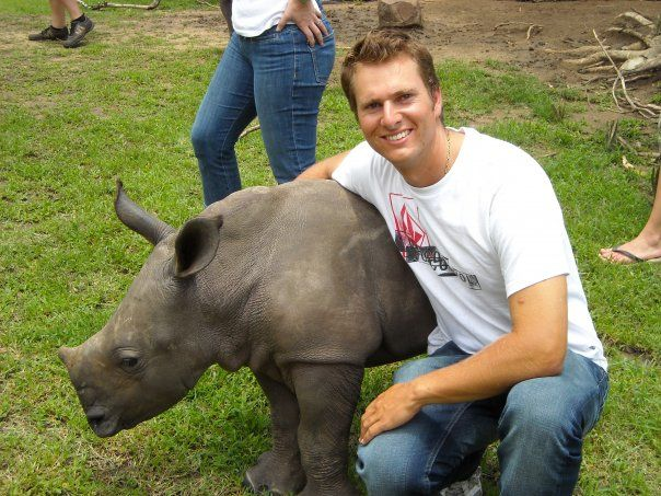 Tim Brown with a White Rhino Calf