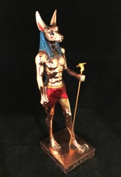 Anubis Bronze coloured statue, Approx 31cm High. Represented as a dog, or as a man with a dogs head, Anubis was a god of the dead, closely associated with the process of mummification and embalming.  Made in Egypt