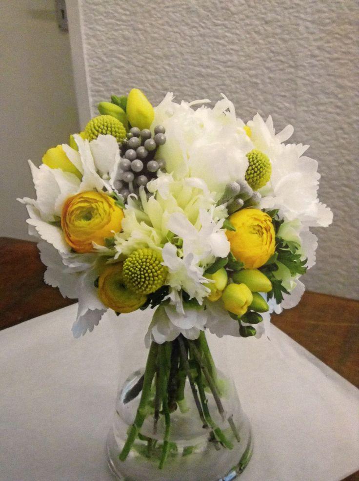 Wedding bouquet using renunculus, peonys, brunia, freesia, craspedia and hydrangea. Tied with brown garden string.