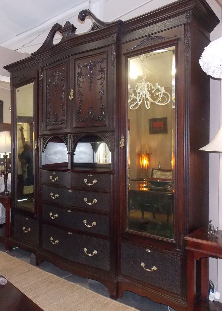A masterpiece antique wardrobe fully restored to its former beauty. This piece will be loved for generations to come!