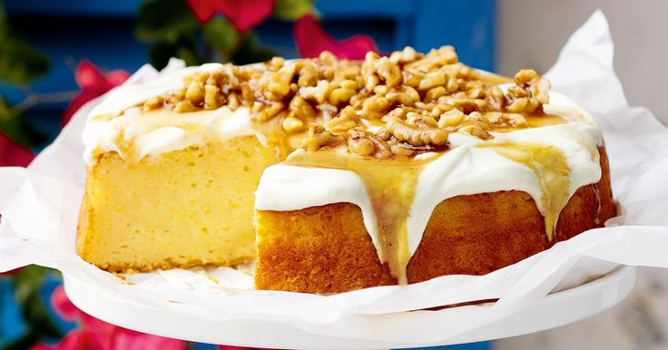 Serve this luscious cake warm with a drizzle of syrup over the top and serve with extra yoghurt on the side.