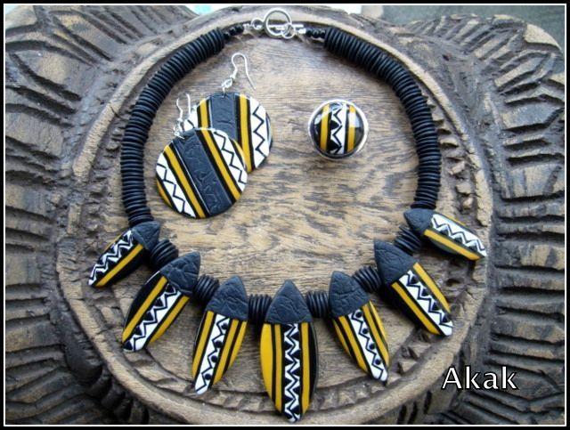 CéWax, Créations textiles et bijoux ethniques en wax, tissu africain. Pièces uniques et fabriquées à la main en France http://cewax.alittlemarket.com Retrouvez toutes les sélections ethno tendance de CéWax sur le blog : https://cewax.wordpress.com  - parure ethnique jaune et noire