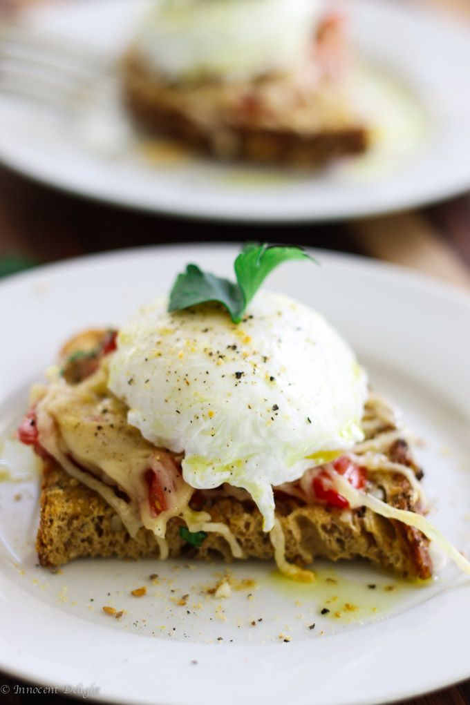 Poached egg on parmesan tomato toast - Innocent Delight
