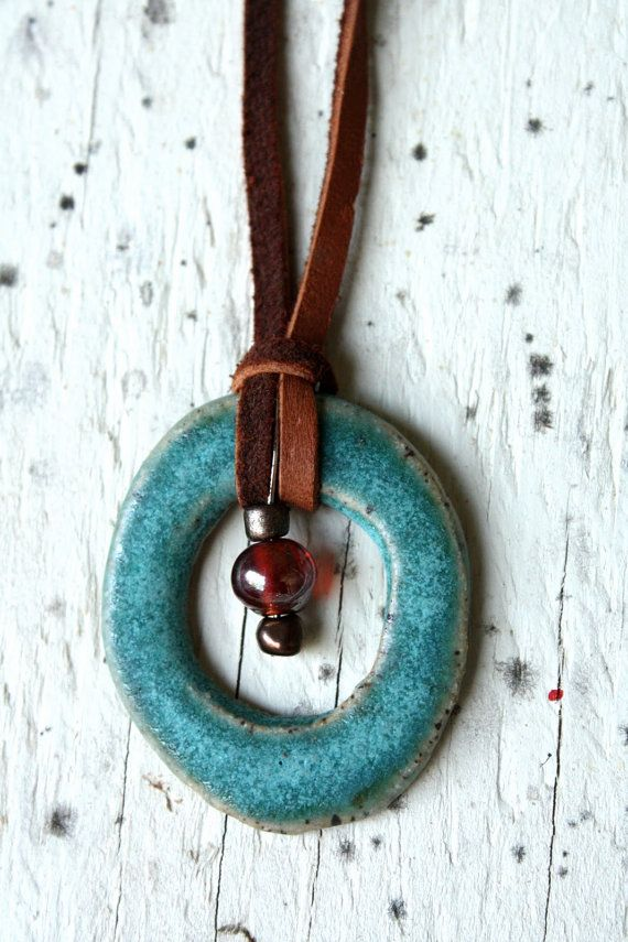 Circle pendant with beads in center