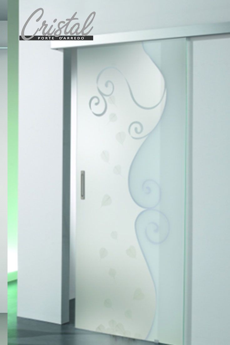 Ricordi-A con vere foglie naturali nella porta in vetro stratificato Cristal. Porta scorrevole esterno muro. Un tocco di natura per gli ambienti interni.
