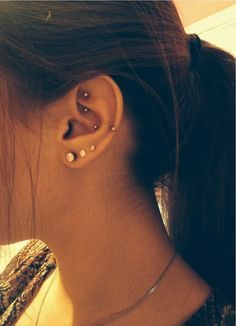 I really dig the auricle/low helix piercing. I was also thinking about getting the diath pierced (below the rook one).