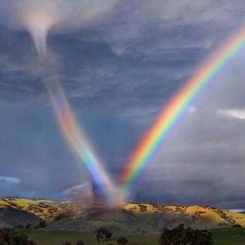 Once in a lifetime shot, a tornado clashes with a rainbow.