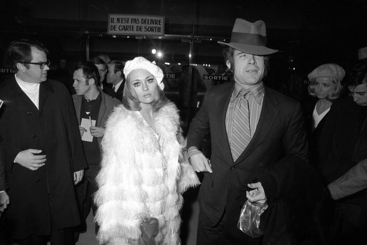 """Raymond Depardon, Faye Dunaway and Warren Beatty at the Paris premiere of """"Bonnie and Clyde,"""" 1968."""
