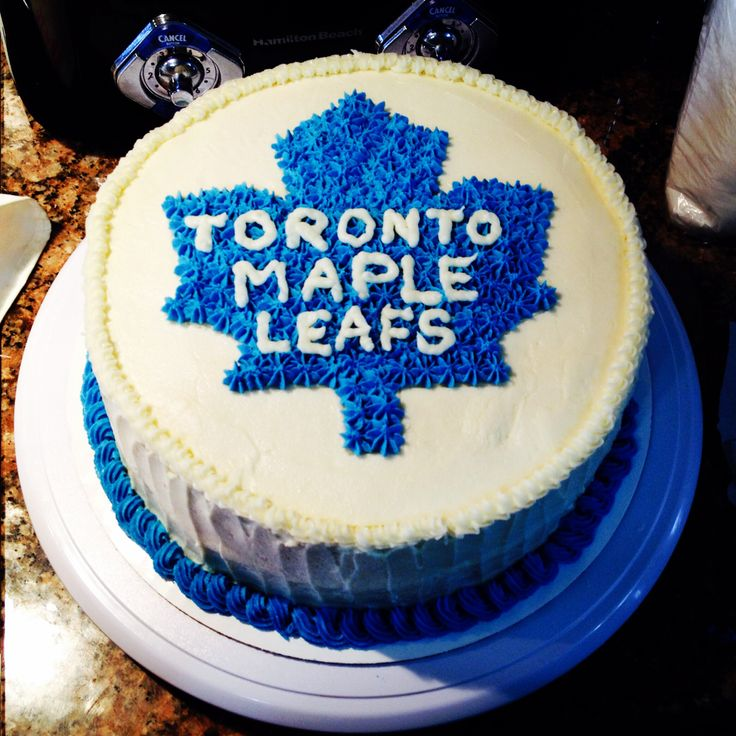 Toronto Maple Leafs cake! For my grandpa's birthday. Simple vanilla cake with white chocolate filling and buttercream icing. Yum!