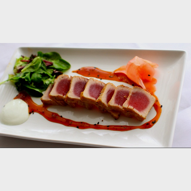 Tuna that is seared rare with sweet & sour Asian sauce, pickled ginger ...