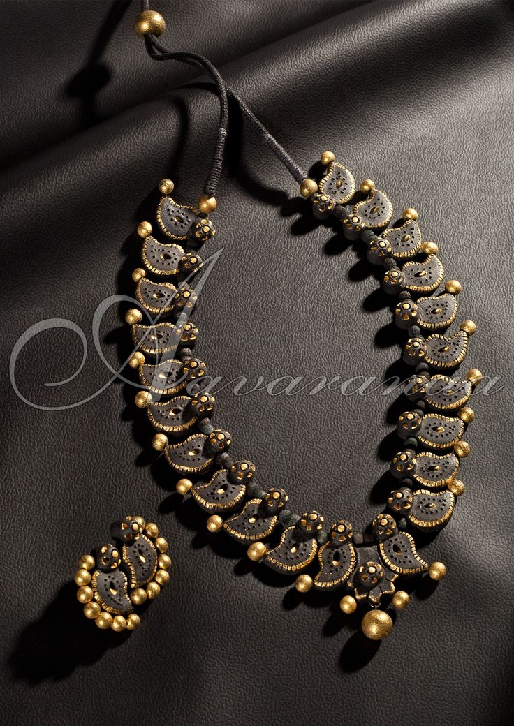Buy online terracotta jewellery from Aavaranaa.com which is leading online sarees shop provides latest designers sarees and designer terracotta jewellery for make women beautiful, we provide it at affordable cost in India.