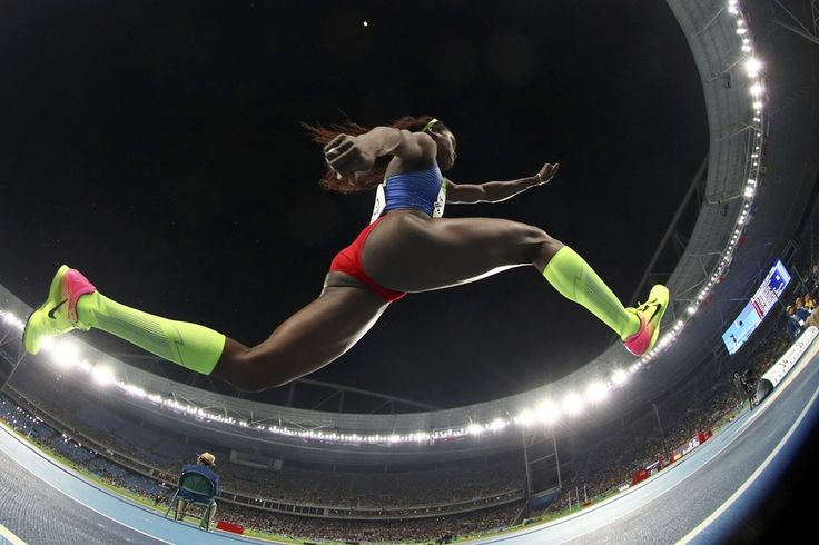 Caterine Ibarguen of Colombia won the women's triple jump gold medal with a LEAP…