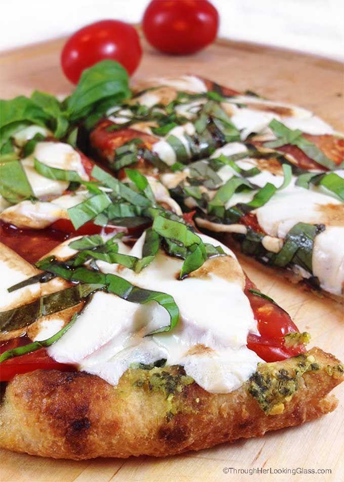 Caprese Pesto Flatbread. Fresh basil pesto, tomatoes, fresh mozzarella and drizzle of balsamic vinegar combine for a fresh & delicious flatbread pizza.