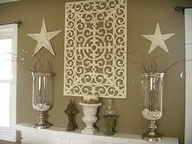 spray paint a rubber door mat and turn it into wall art