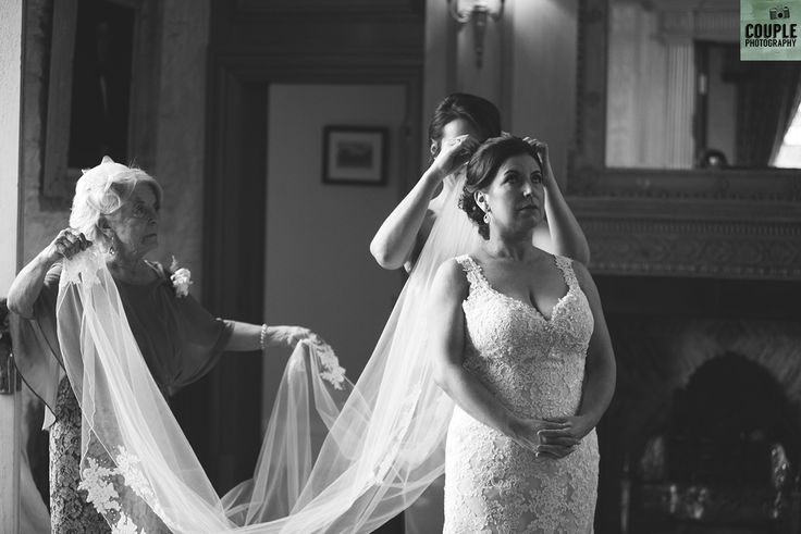The long veil is added to finish the look.  Weddings by Couple Photography. www.couple.ie