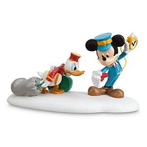 Disney Donald Duck and Mickey Mouse ''Hurry Up, Donald'' Figurine by Dept. 56 | Disney StoreDonald Duck and Mickey Mouse ''Hurry Up, Donald'' Figurine by Dept. 56 - Train conductor Mickey Mouse runs a tight schedule and saggy steward Donald is dragging a bit behind for this fun storytelling sculpture by Dept. 56, a festive figurine addition for your Mickey's Holiday Village Scene.